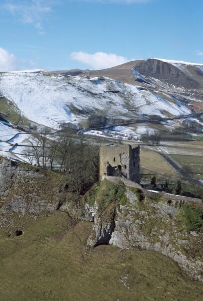 PEVERIL CASTLE, Castleton, Peak District, Derbyshire. A view from the South East looking across Cavedale towards the Keep with Mam Tor in the distance