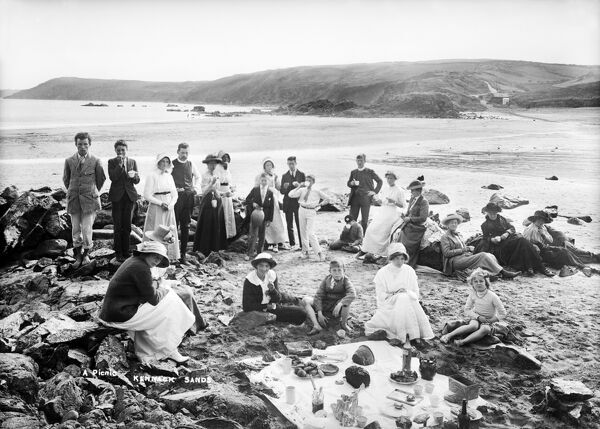 KENNACK SANDS, St Keverne, Cornwall. A group having a picnic on the beach at Kennack. Photographed by Alfred Newton and Son between 1896 and 1914