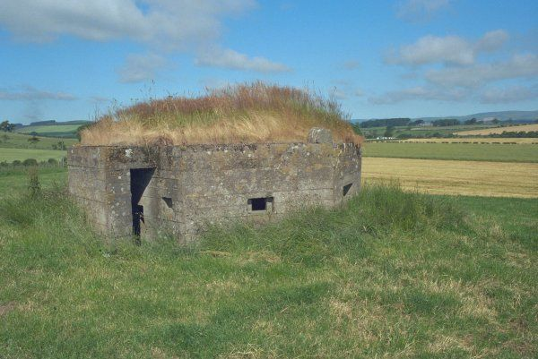 Tosson, Northumberland. This pill box was constructed c.1940 as part of the Coquet Line of defence against German invasion during the 2nd World War. IoE 407945