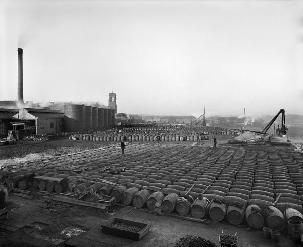 LEVER BROTHERS SUNLIGHT SOAP WORKS, Port Sunlight, Wirral, Merseyside. Photographed by Bedford Lemere & Co. in April 1897. Thousands of barrels of tallow and other soap ingredients stacked in rows, with factory buildings in the background left