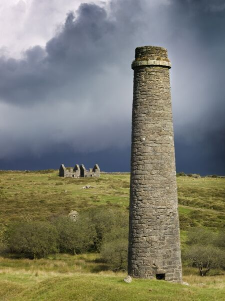 DARTMOOR, Devon. Remains of the Powder Mills at Postbridge, with chimney in the foreground, against an overcast sky