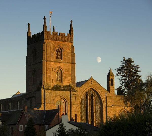 THE PRIORY CHURCH OF ST PETER AND ST PAUL, The Priory, Leominster, Herefordshire. Exterior evening view with moon above