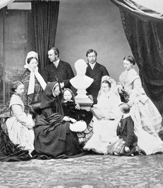 OSBORNE HOUSE, Isle of Wight. Photograph from a Royal Family album. Queen Victoria and her family. Windsor. 1863. Photograph possibly taken at the time of the Prince of Wales' marriage and the family were arranged around a bust of Albert