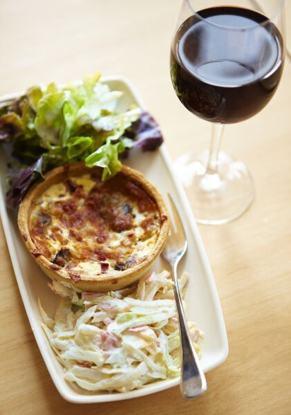 Kentish crab and watercress quiche with a glass of red wine