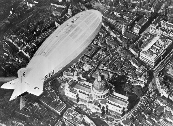 The R101 flying over St Paul's Cathedral during a test flight 1929-1930. Probably a composite photo montage. Aerofilms Collection (see Links)