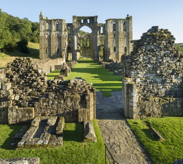 RIEVAULX ABBEY, North Yorkshire. Church, North and South Transepts showing Nave in centre with Gallillee Porch in foreground, view from west