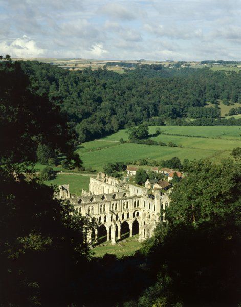 RIEVAULX ABBEY, North Yorkshire. An elevated view from the hillside showing the abbey and surrounding countryside