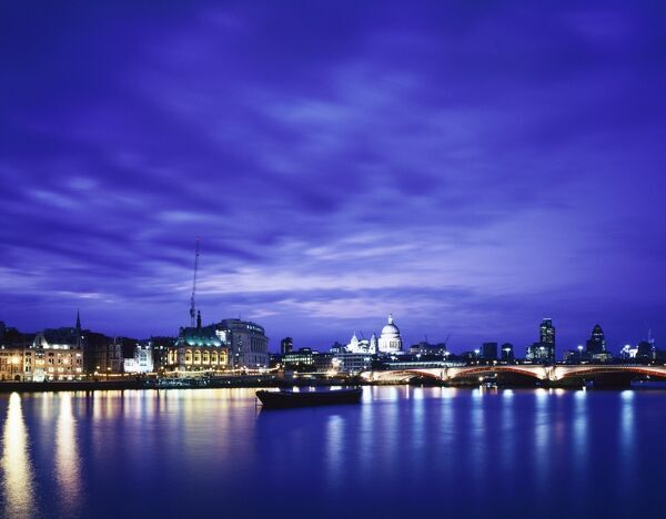 RIVER THAMES, London. Urban landscape of River Thames, Blackfriars Bridge, St Paul's, Swiss Re building etc. at night