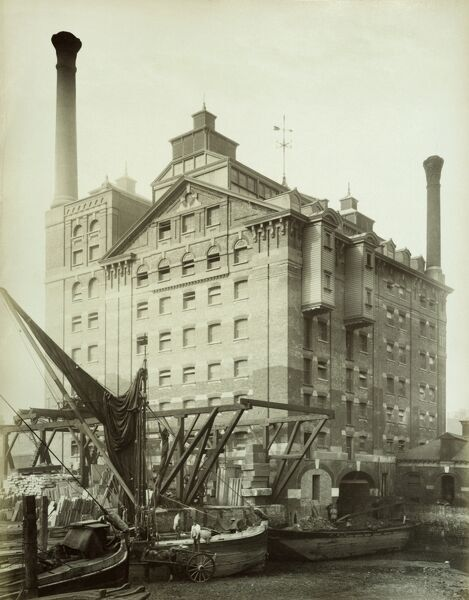 ROBINSONS FLOUR MILL, Deptford, London. General view with boats in the foreground. Photographed by Bedford Lemere in 1883