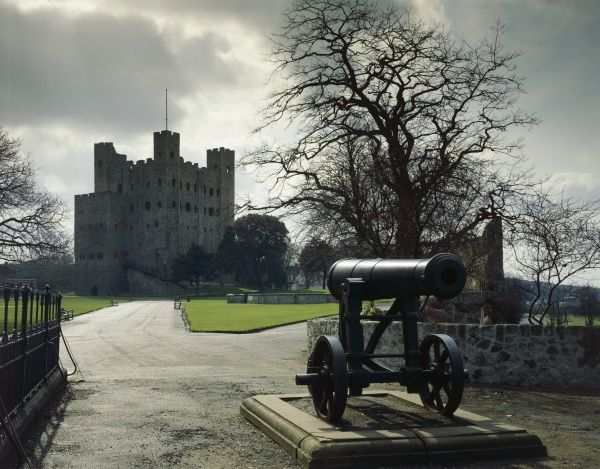 Rochester Castle, Kent. General view of the castle in winter with a cannon in the foreground