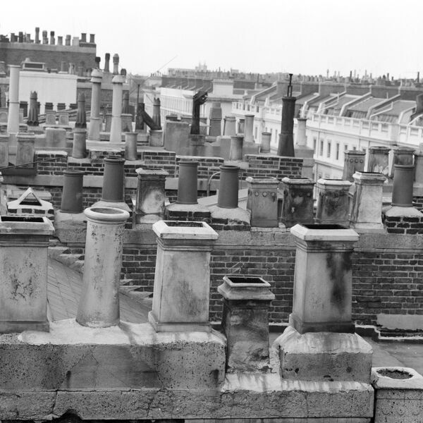 EATON PLACE, Belgravia, London. A view of the rooftops of Eaton Place, Westminster showing rows of chimneys and chimney pots. Photographed by John Gay. Date range: January 1962-May 1964