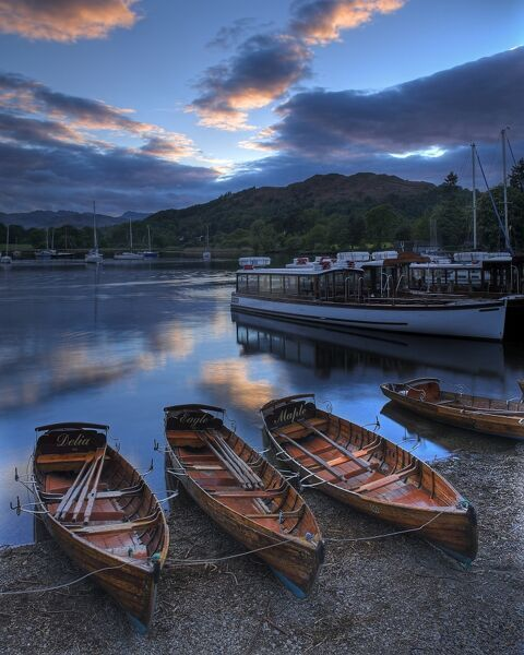 LAKE WINDERMERE, Lake District National Park, Ambleside, Cumbria. Rowing boats at sunset