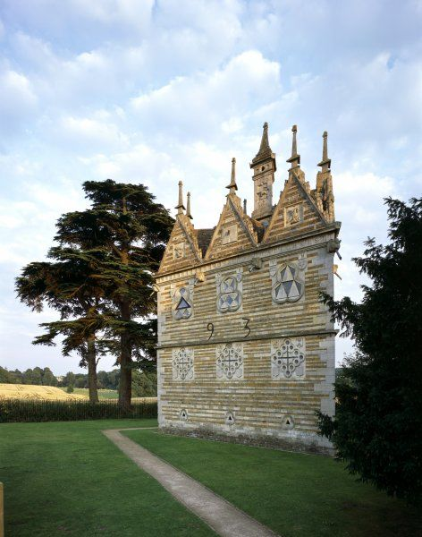 RUSHTON TRIANGULAR LODGE, Northamptonshire. View from the North West with Rushton Hall in the distance