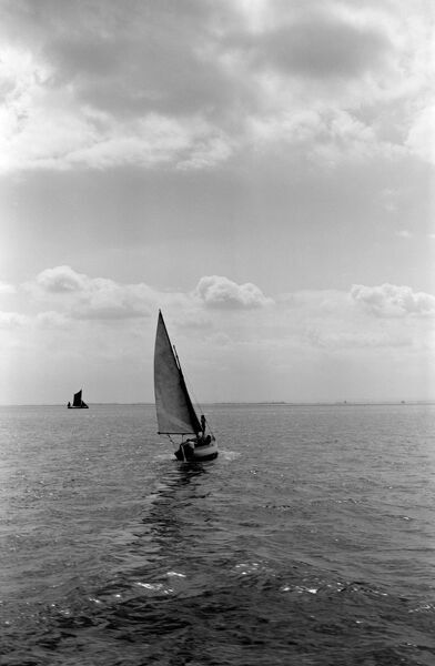SAILING BOAT, Southend on Sea, Essex. A small sailing boat turning in the wind off Southend-on-Sea. Photographed by Stanley W Rawlings. Date range: 1945 - 1965