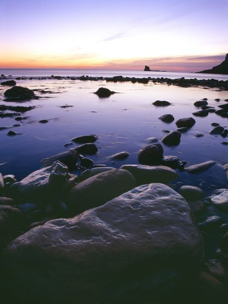 SALTWICK BAY, North Yorkshire. View of Saltwick Bay and Black Nab rock at sunrise