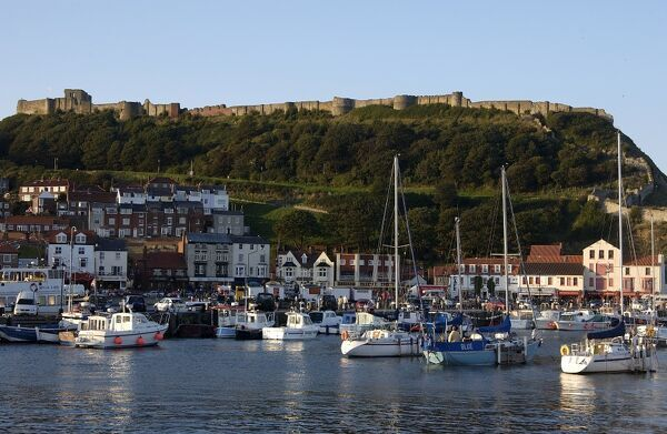 SCARBOROUGH CASTLE, North Yorkshire. The castle and headland overlooking the town and harbour with yachts at anchor