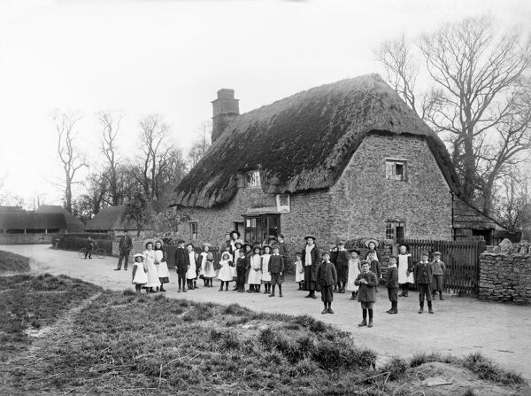Post Office, Hinton Waldrist, Oxfordshire. A large group of school children standing in the road outside the village post office. Photographed by Frederick Ault in 1900. From the Henry Taunt Collection