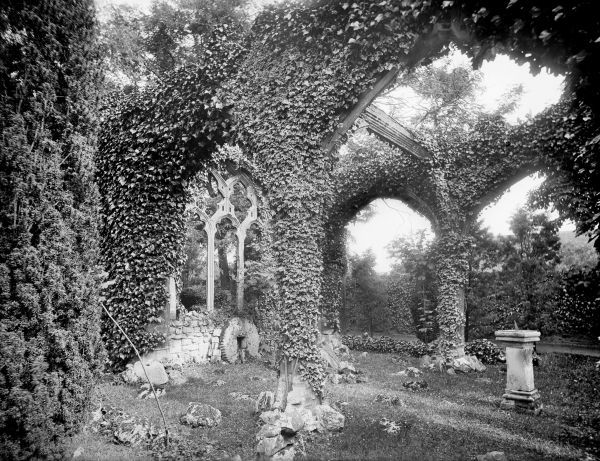 ABINGDON, Oxfordshire. Overgrown arcades and windows of the sham abbey ruin in the gardens of Abingdon Abbey. Photographed in 1892 by Henry W Taunt