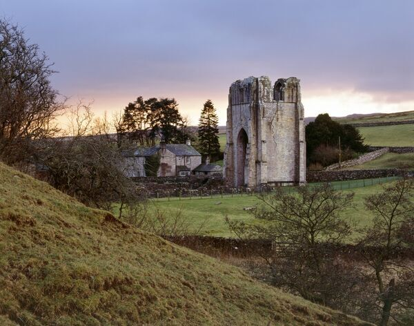 SHAP ABBEY, Cumbria. View of the Abbey with the sun setting behind the west Tower