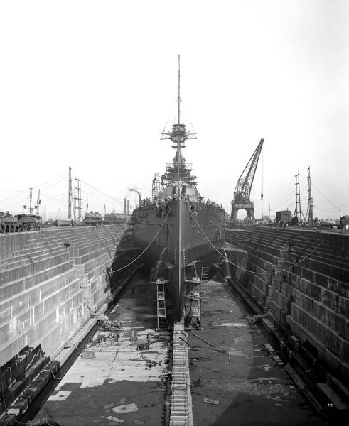 CAMMELL LAIRD SHIPYARD, Birkenhead, Merseyside. General view showing a ship in drydock. The ship may be called ' Audacious '. Photographed in June 1913 by Bedford Lemere