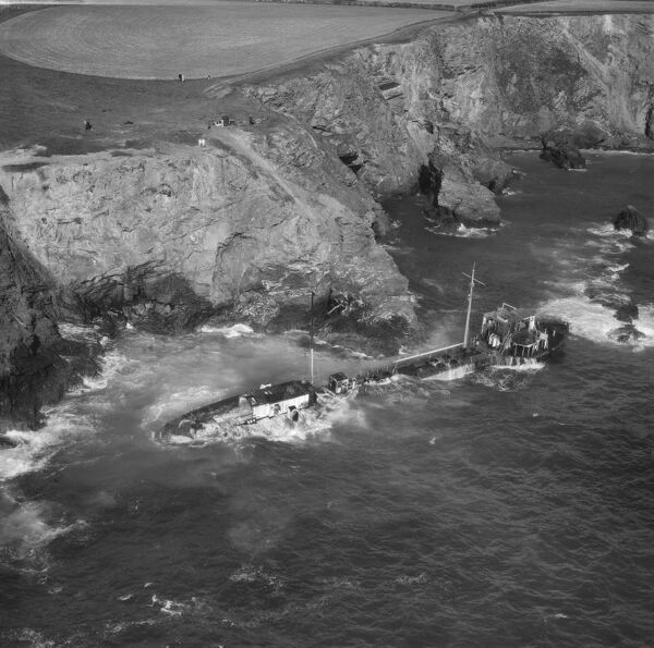 "The wreck of the tanker ""Hemsley I"" at Fox Cove, St Merryn, Cornwall. September 1969. The vessel went ashore here on 12th May 1969 en route from Liverpool to Antwerp. Aerofilms Collection"