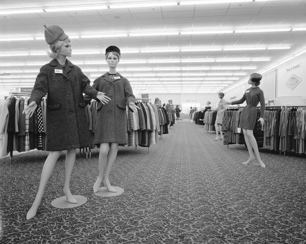 Woolco, Allensway, Thornaby, Stockton-On-Tees. The women's clothing department at the new Woolco department store in Thornaby with coats and dresses displayed on mannequins. 19th August 1968. John Laing Collection