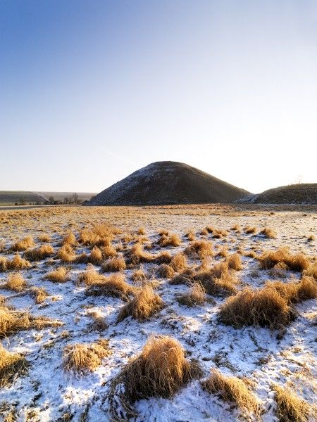 SILBURY HILL, Avebury, Wiltshire. View across a frost laden field looking towards Silbury Hill