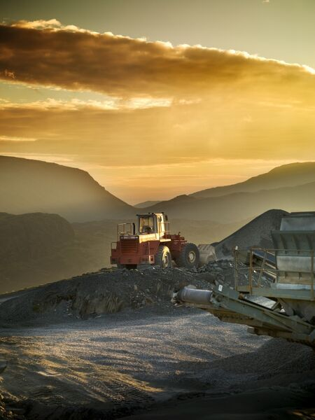 SLATE QUARRY, Cumbria. General view of a slate quarry mine landscape at sunset. Industrial vehicles and machinery