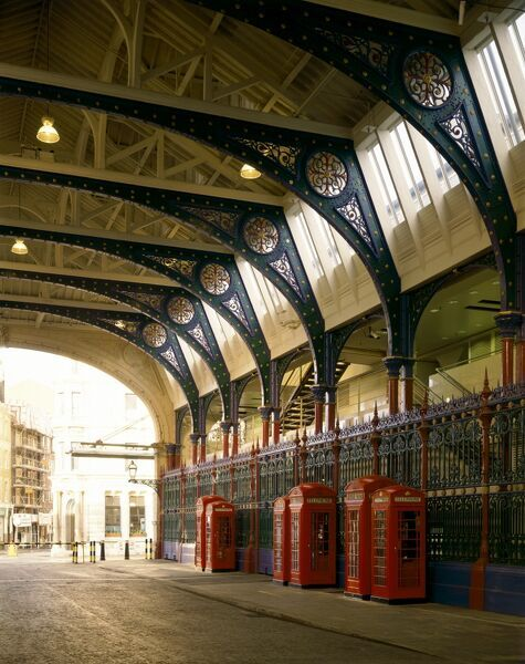 SMITHFIELD MARKET, City of London. Interior view of Grand Avenue with red K2 and K6 type telephone kiosks