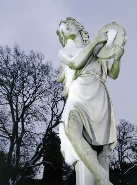 WREST PARK HOUSE AND GARDENS, Bedfordshire. View of one of the garden statues in the snow