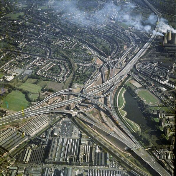 "Gravelly Hills Interchange, Birmingham. Junction 6 on the M6 motorway meets the A38 and A5127 in a complex known as ""Spaghetti Junction"". Photographed by Aerofilms in 1971, before being fully opened the following year"