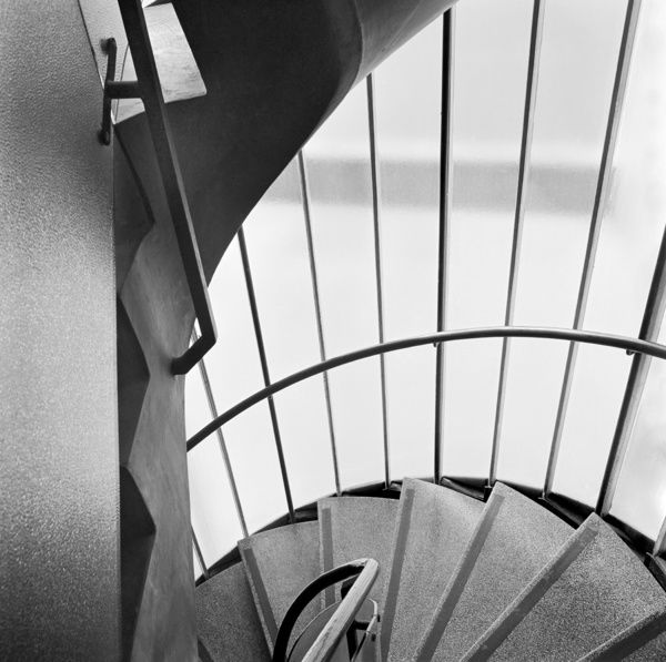 PYRAMID HOUSE, 948-956 High Road, Finchley, London. Interior view looking down stairs in the glazed, spiral stair turret. Photographed by John Gay. Date range: 1966 - 1975
