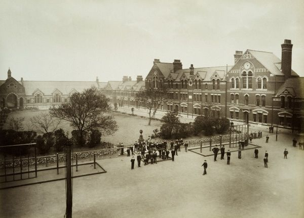 SPURGEONS ORPHANAGE, Stockwell, Brixton, Lambeth, London. Elevated exterior view showing children gathered outside the orphanage. Photographed in 1884 by Bedford Lemere