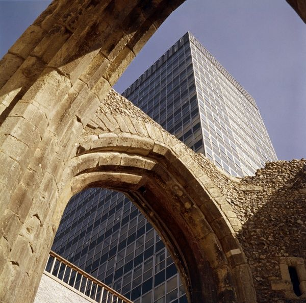 The ruins of St Alphage Church with the newly built St Alphage House tower block in the background, part of the ambitious post-war renewal of London Wall. Photographed by John Gay, c.1962