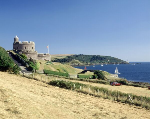 ST MAWES CASTLE, Cornwall. View of the castle with the lighthouse of St. Anthony's Head in the distance