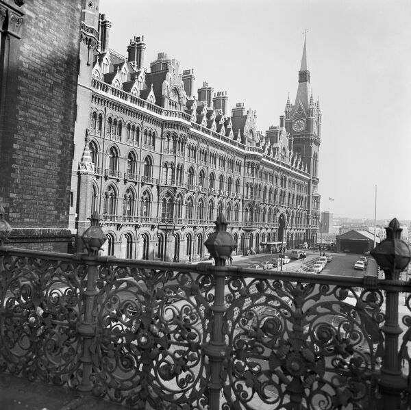ST. PANCRAS STATION, London. An elevated view looking along the Euston Road frontage of St Pancras Station seen from behind the railings on the top of the porte cochere of the the Midland Grand Hotel. Photographed by John Gay. Date range: 1960-1972