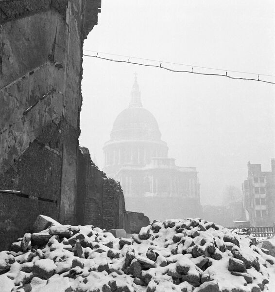ST PAUL'S CATHEDRAL, London. The cathedral in mist with the snow-covered ruins of a bomb damaged building in the foreground. Photographed by John Gay in 1947