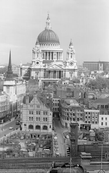 CITY OF LONDON. An elevated view of the City of London looking towards St Paul's Cathedral. The empty building plots being used as car parks in the foreground are bomb sites which had still not been developed when the photograph was taken