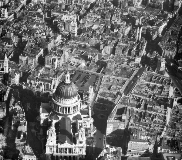 ST PAUL'S CATHEDRAL, London. Aerial view. In this photograph of October 1947 the Cathedral still survives, but the widespread devastation caused by bombing during the Second World War is apparent in nearby streets. Some whole blocks have been destroyed