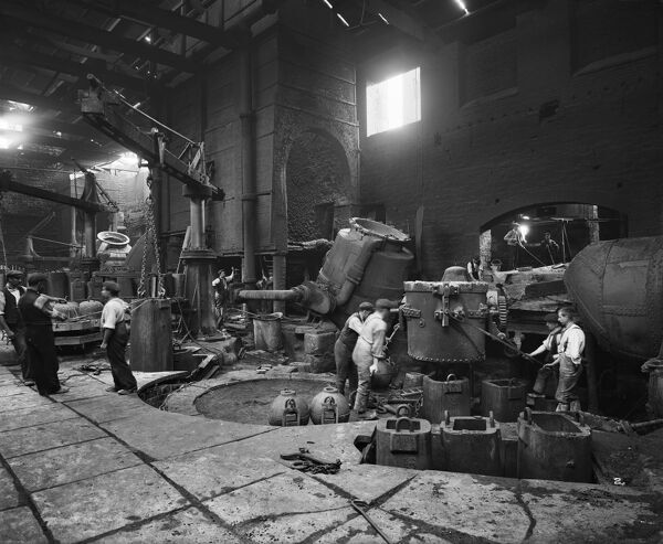 Cammell Laird & Co, Penistone. Men at work in Cammell Laird's bessemer department, producing steel from pig iron. One of a series of photographs of Cammell Laird works. Bedford Lemere. August 1913