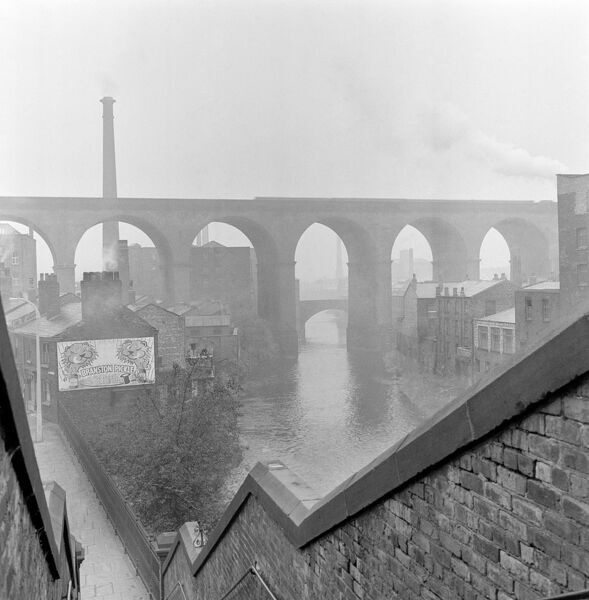 RAILWAY VIADUCT, Stockport, Greater Manchester. This evocative urban landscape shows the railway viaduct in Stockport, looking along the river. Photographed by Eric de Mare in 1954