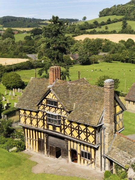 STOKESAY CASTLE, Shropshire. An elevated view of the seventeenth century timber framed Gatehouse with countryside beyond