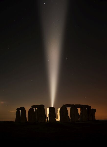 STONHENGE, Amesbury, Wiltshire. View of Stonehenge with a single beam of light for the centenary to mark the outbreak of the First World War. Shot after twilight