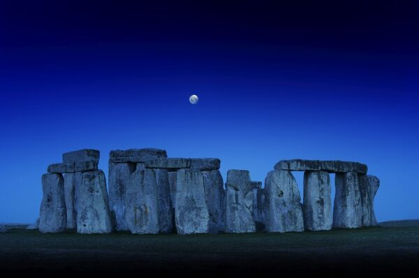 STONEHENGE, Wiltshire. General view at dusk with moon