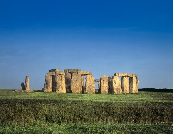 STONEHENGE, Wiltshire. General view against a blue sky