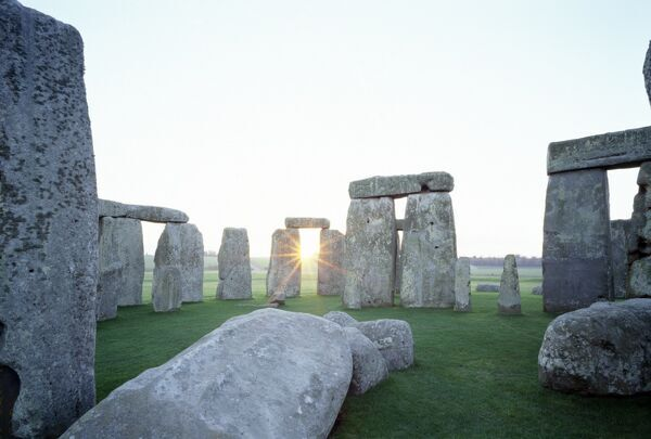 STONEHENGE, Wiltshire. View from the North West at sunrise