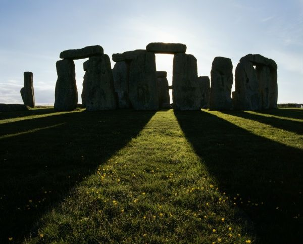 Stonehenge, Wiltshire. View from the South East of the stones at midsummer sunset
