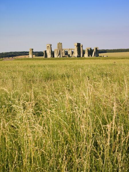 STONEHENGE, Wiltshire. General view of the stones with long grass in the foreground