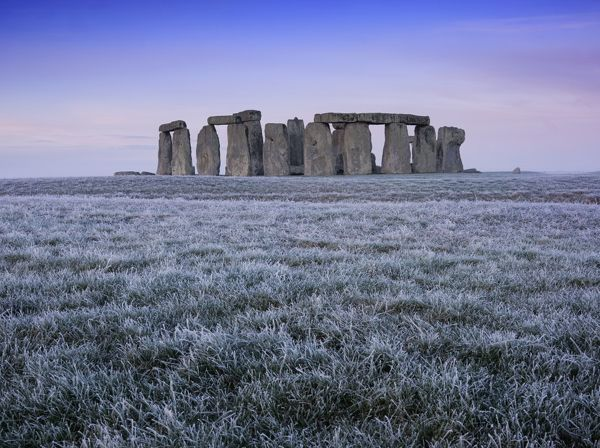 STONEHENGE, Wiltshire. View of the stone cirlce at early dawn