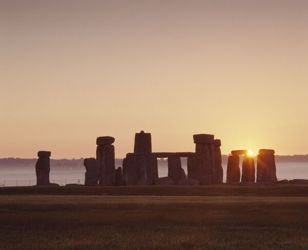 STONEHENGE, Wiltshire. General view at sunrise from the west